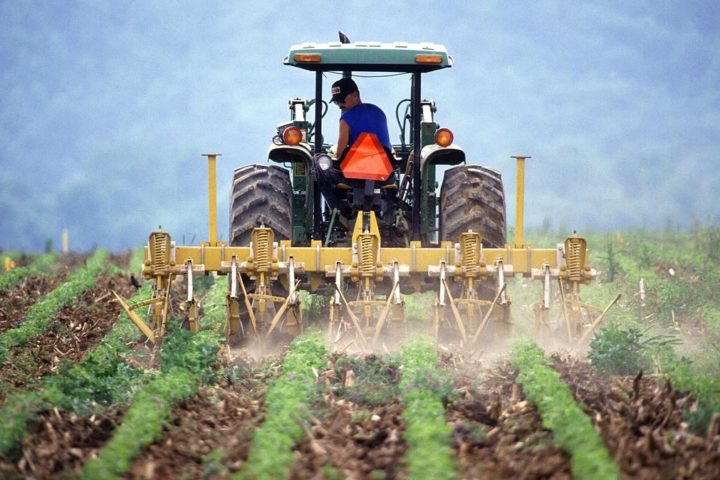 1024px-farmer_and_tractor_tilling_soil